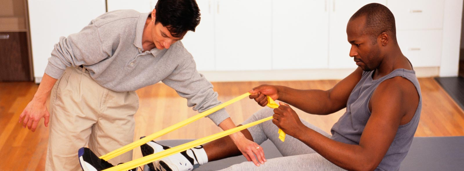 1to1 physiotherapist assisting a patient with excercises