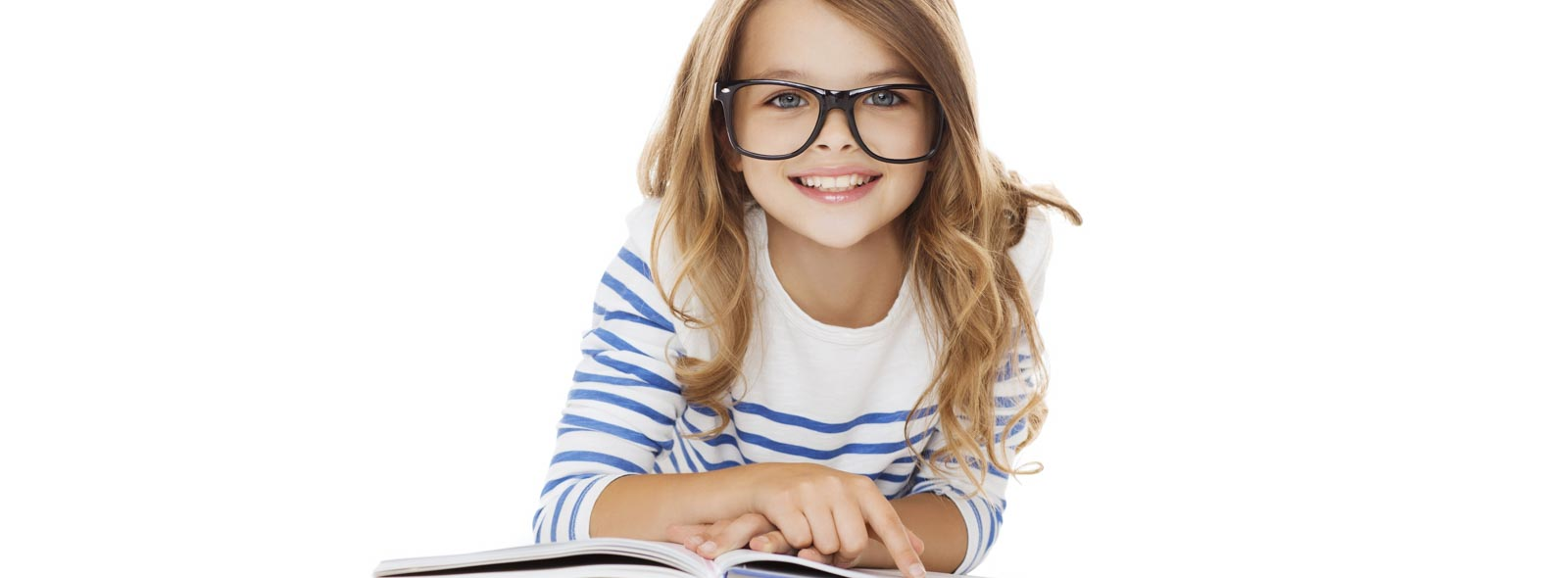 girl with glasses smiling lying on book